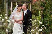bride and groom in a garden by Tallmadge wedding photographer, Akron wedding photographer Mara Robinson Photography