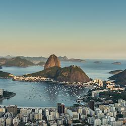 Sugarloaf mountain and the city of Rio de Janeiro at sunset, Rio de Janeiro, Brazil.