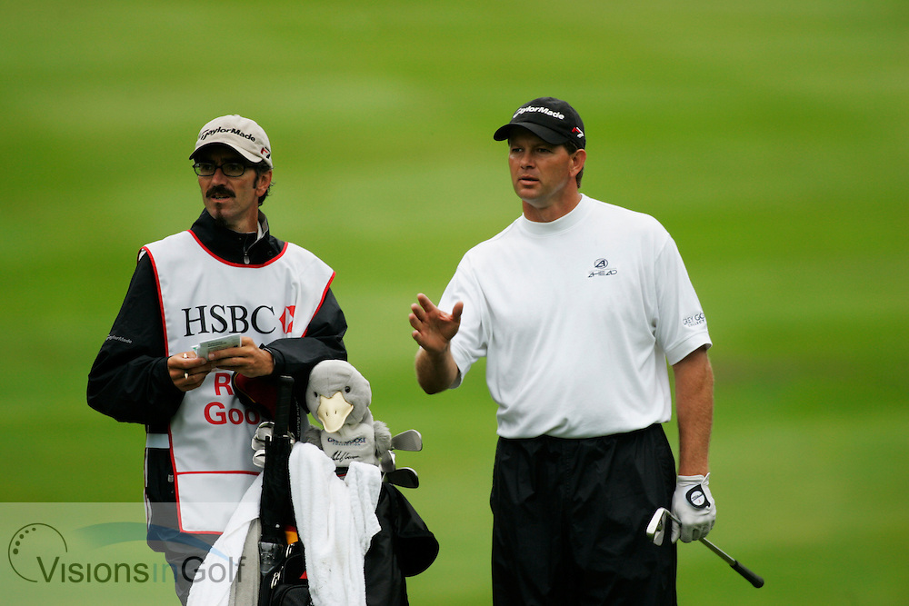 Retief Goosen with caddy<br />