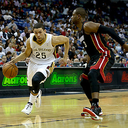Oct 23, 2013; New Orleans, LA, USA; New Orleans Pelicans shooting guard Austin Rivers (25) drives past Miami Heat guard Dwyane Wade (3) during the first half of a preseason game at New Orleans Arena. Mandatory Credit: Derick E. Hingle-USA TODAY Sports