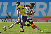 Bradford City defender Nat Knight-Percival (22) tackles Oxford United striker Wes Thomas (9) 0-0 during the EFL Sky Bet League 1 match between Oxford United and Bradford City at the Kassam Stadium, Oxford, England on 15 October 2016. Photo by Alan Franklin.