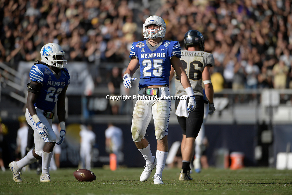 Memphis defensive back Austin Hall (25) sets up for a play during the second half of the American Athletic Conference championship NCAA college football game against Central Florida Saturday, Dec. 2, 2017, in Orlando, Fla. Central Florida won 62-55. (Photo by Phelan M. Ebenhack)