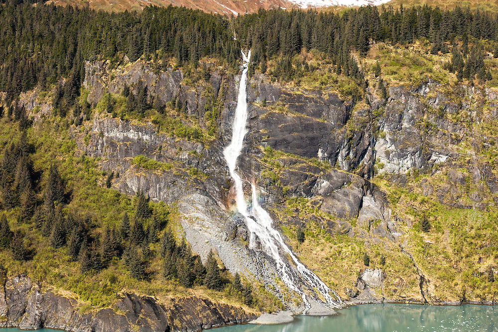 Cascading waterfall from snow melt in Chugach Mountains in Prince William Sound in Southcentral Alaska. Spring. Morning.