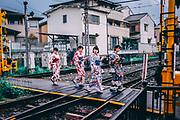 every day Street scene in Japan. Japanese women in traditional Kimono