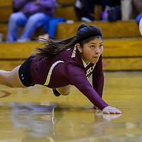 Tohatchi Cougar Cheyenne Begay (9) dives to save a shot from the Crownpoint Eagles Thursday at Crownpoint High School.