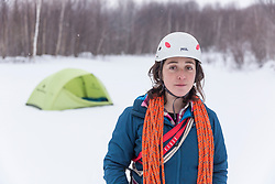 A woman in ice climbing gear in New Hampshire's White Mountains.