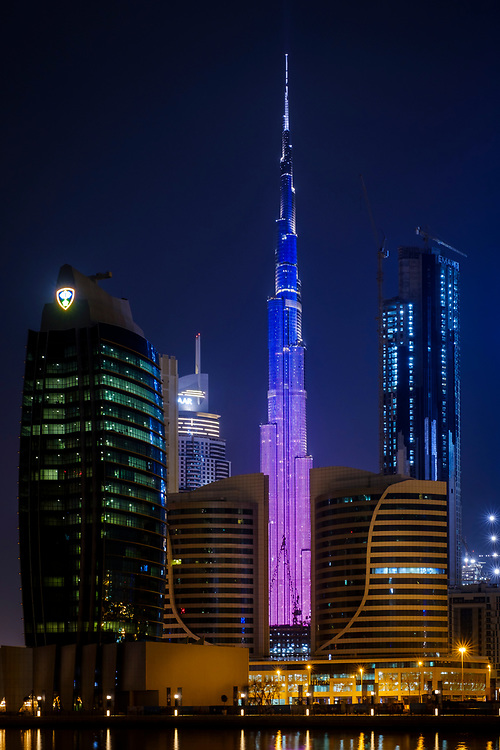 UNITED ARAB EMIRATES, DUBAI - CIRCA JANUARY 2017: View of the Burj Khalifa and the LED Light Show as seen from Business Bay in Dubai. The skyscraper is the tallest building of the world, an icon of the city and a very popular tourist attraction.