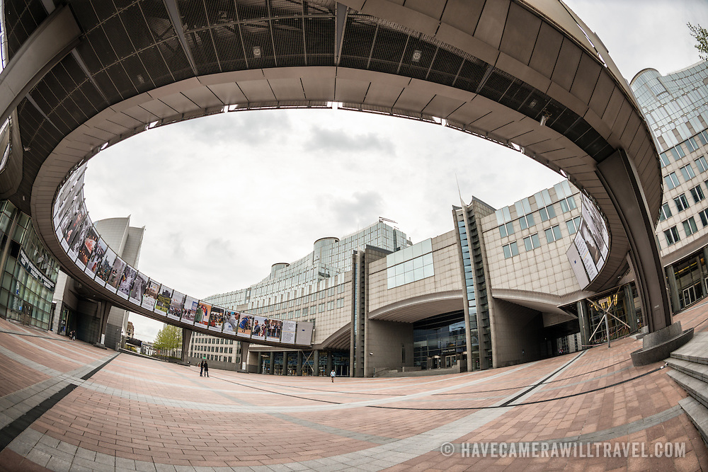 A wide-angle shot of the circular walkway that runs over the main plaza in front of the European Parliament Building in Brussels, Belgium.