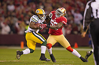 12 January 2013: Runningback (26) DuJuan Harris of the Green Bay Packers runs and is tacked by (52) Patrick Willis of the San Francisco 49ers during the first half of the 49ers 45-31 victory over the Packers in an NFL Divisional Playoff Game at Candlestick Park in San Francisco, CA.