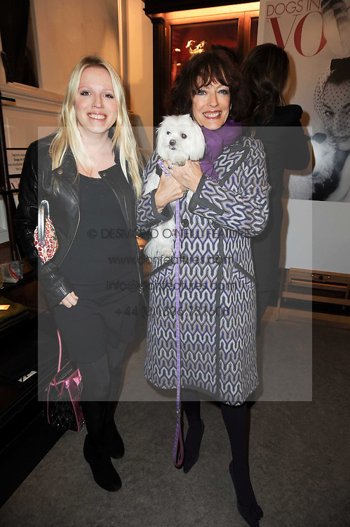 Left to right, KITTY HODGES, her mother BEL MOONEY and her dog Bonnie at a party to celebrate the publication of Dogs in Vogue by Judith Watt held at James Purdey & Sons, Audley House, 57-58 South Audley Street, London W1 on 3rd December 2009.