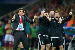 LILLE, FRANCE - Friday, July 1, 2016: Wales manager Chris Coleman celebrates his sides second goal against Belgium during the UEFA Euro 2016 Championship Quarter-Final match at the Stade Pierre Mauroy. Ryland Morgans (Pic by Paul Greenwood/Propaganda)