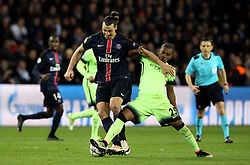 Zlatan Ibrahimovic of Paris Saint-Germain is tackled by Fernandinho of Manchester City - Mandatory by-line: Robbie Stephenson/JMP - 06/04/2016 - FOOTBALL - Parc des Princes - Paris,  - Paris Saint-Germain v Manchester City - UEFA Champions League Quarter Finals First Leg