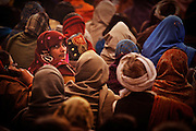 A woman in a theater tent in Kumbh Mela..Pilgrims after the holy bath can join shows in the tents.