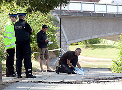 © London News Pictures. 09/07/2011. Maidstone, Kent. Police and forensics examine the scene of a boat fire on the River Medway, Maidstone today (09/07/2011) in which a 49 year old man has died. Emergency services were called to the boat on the River Medway by St peter's Street just after 2am this morning (09/07/2011) .Picture credit should read Manu Palomeque/LNP