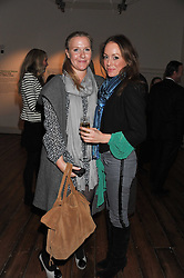 Left to right, the HON.LUCY MYNERS and CANDY SCHLESINGER at a private view of AMAZON an exhibition of photographs in aid of 'Sky Rainforest Rescue' held in the East Wing Galleries, Somerset House, London on 1st November 2011.