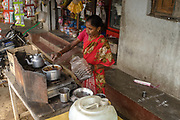 A woman prepares tea using Safe Water Network iJal water at a stall in village Gorikothapally, Telangana, Indiia, on Friday, February 8, 2019. Photographer: Suzanne Lee for Safe Water Network