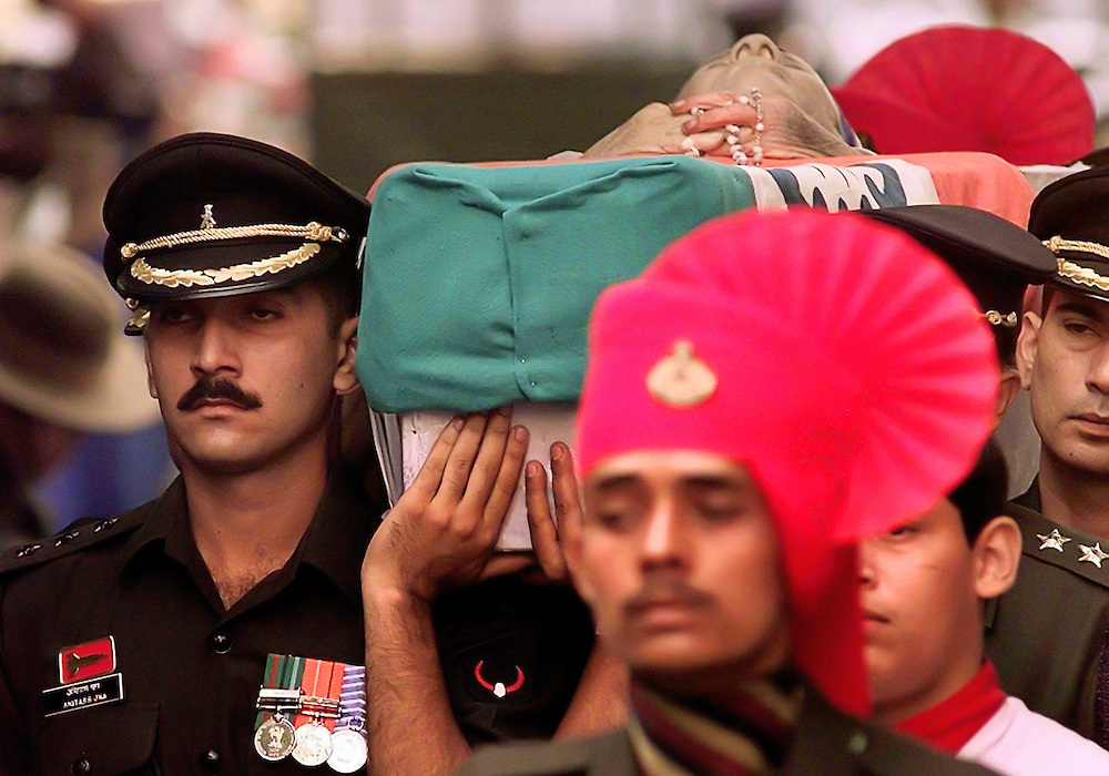 Mother Teresa in her open casket is carried by Indian military officers from Saint Thomas' Church to a gun carriage in Calcutta, Saturday, Sept. 13, 1997. The gun carriage took her remains to the Netaji Indoor Stadium for a funeral mass. (AP Photo/David Longstreath)