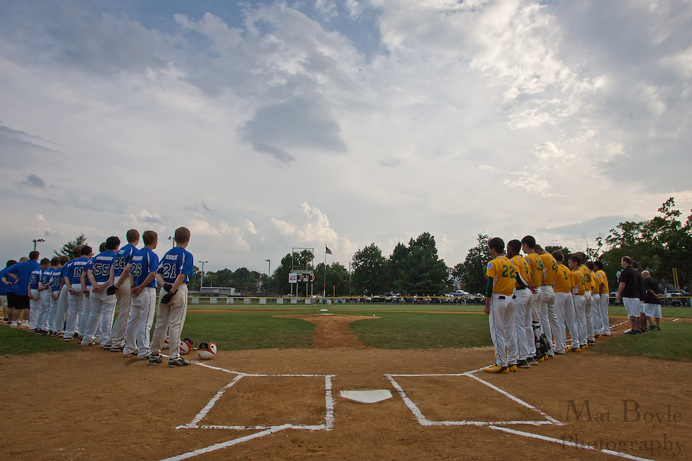 The Erial and Cherry Hill teams stand for the National Anthem before the Section 4 Little League final held in Gloucester Sunday night.