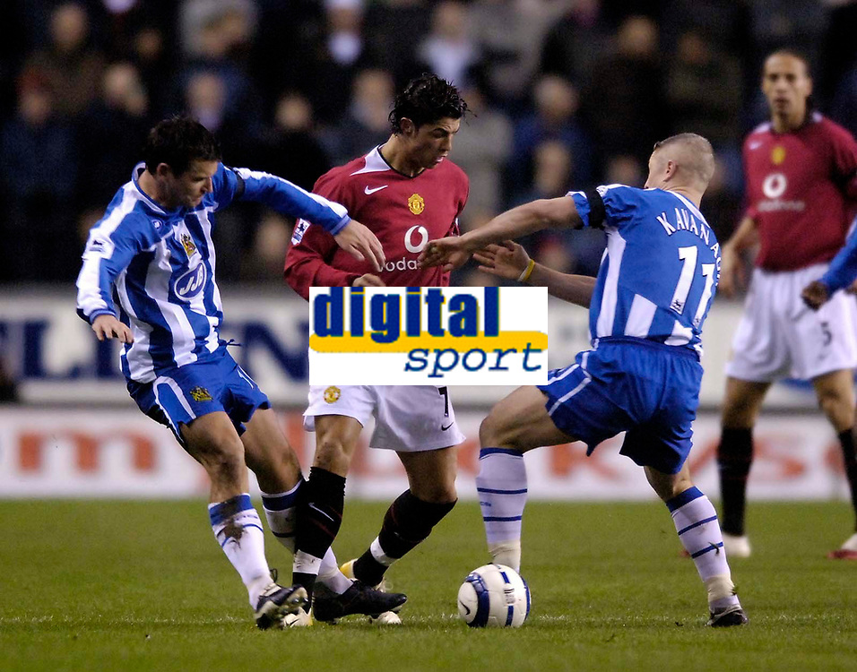Photo: Jed Wee.<br /> Wigan Athletic v Manchester United. The Barclays Premiership. 06/03/2006.<br /> <br /> Manchester United's Cristiano Ronaldo (C) finds himself crowded out by Wigan's Graham Kavanagh (R) and Lee McCulloch.