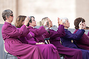 Rome oct 7th 2015, weekly general audience in St Peter's Square. In the picture some american women bishops of episcopal church take picture of the pope with smartphones