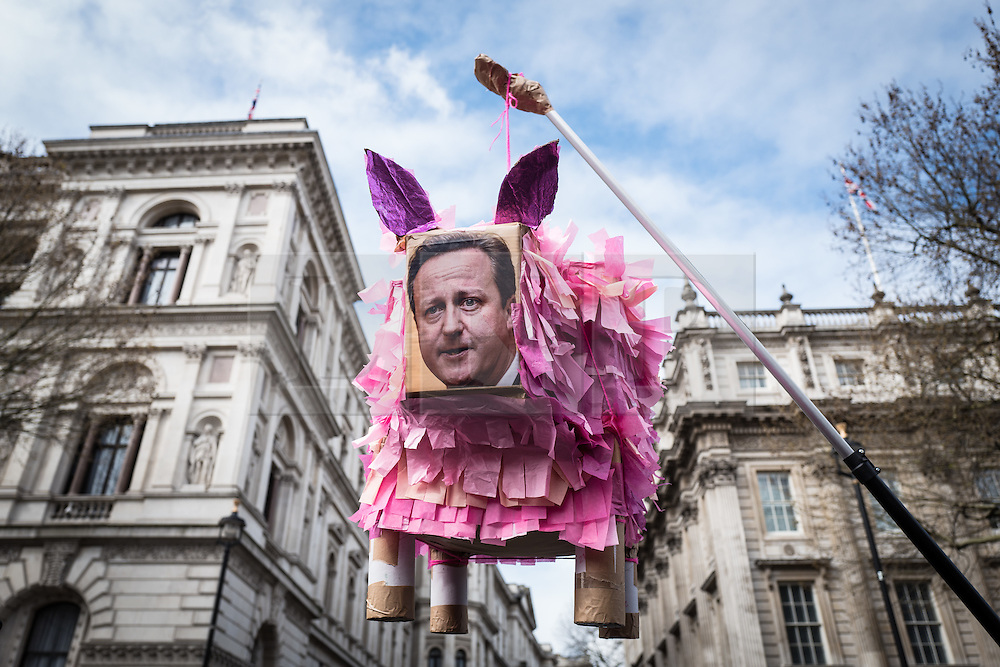 © Licensed to London News Pictures. 09/04/2016. London, UK. A sculture of British Prime Minister David Cameron as a pig is waved in front of Downing Street as thousands gather on Whitehall to demand his resignation after he admitted to profiting from the sale of shares worth more than £30,000 in Blairmore Holdings, an offshore investment fund set up by his late father Ian Cameron. The Panama Papers, leaked anonymously from the database of law firm Mossack Fonseca, have revealed the extent to which firms and wealthy individuals use loopholes and offshore funds to avoid paying tax. Photo credit: Rob Pinney/LNP