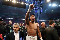 Anthony Joshua celebrates victory over Wladimir Klitschko following the IBF, WBA and IBO Heavyweight World Title bout with Mayor of London Sadiq Khan at Wembley Stadium, London.