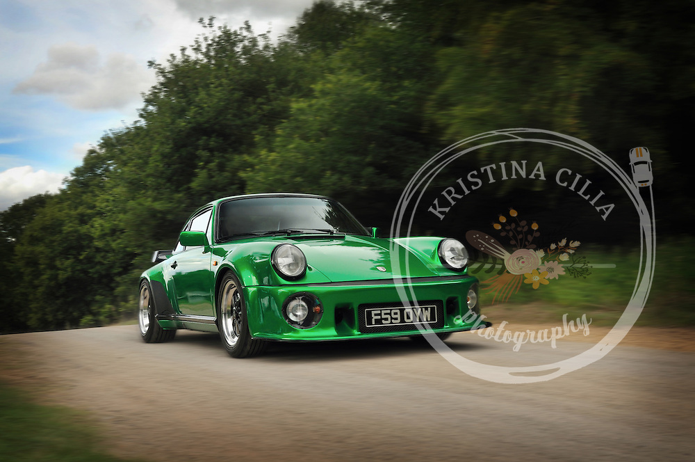 A metallic green Porsche 911 at Classics at the Castle, Castle Hedingham, England. Photo by Kristina Cilia