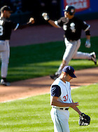 MORNING JOURNAL/DAVID RICHARD<br />Cleveland pitcher Jake Westbrook, front, looks to the ground after giving up a 3-run home run to Chicago's Tadahito Iguchi, back right, yesterday in the seventh inning.