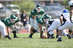 15 September 2007:  On the line (l - R), Keely Flood, Kraig Ladd, and Eric Van Hise. The Titans stood toe to toe with the 25th ranked Lions through the first half but ended the game on the losing end of a 25-15 score at Wilder Field on the campus of Illinois Wesleyan University in Bloomington Illinois.