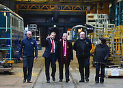 © Licensed to London News Pictures. 25/02/2013. Eastleigh, UK. Eastleigh Borough Council Leader, Keith House (Red tie), Liberal Democrat Parliamentary Candidate for Eastleigh, Mike Thornton (Pink tie) Barry Stephenson Managing Director of Eastleigh Railway Works and Catherine Bearder, (grey coat) Liberal Democrat Member of the European Parliament for the South East of England, visit Arlington Fleet Services, based at the historic Eastleigh Railway Works site. Today 25th February 2013. Photo credit : Stephen Simpson/LNP