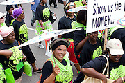 Protestors march during the Global Day of Action that started at the Durban Christian Centre via the Durban International Convention Centre and ended at the beach, 3 Dec 2011