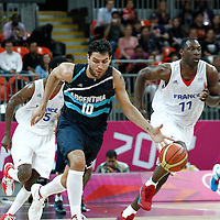 31 July 2012: Carlos Delfino of Argentina brings the ball upcourt for the fast break during 71-64 Team France victory over Team Argentina, during the men's basketball preliminary, at the Basketball Arena, in London, Great Britain.