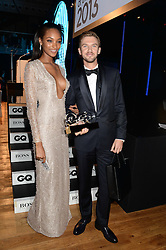 JOURDAN DUNN poses with winner of the Hugo Boss Most Stylish Award DAN STEVENS at the GQ Men of The Year Awards 2013 in association with Hugo Boss held at the Royal Opera House, London on 3rd September 2013.