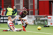 Hearts FC Forward Gavin Reilly getting tackled during the Ladbrokes Scottish Premiership match between Hamilton Academical FC and Heart of Midlothian at New Douglas Park, Hamilton, Scotland on 24 January 2016. Photo by Craig McAllister.