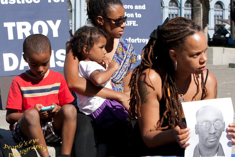 Today, 21 September 2012, marks a year since the state sanctioned murder of Troy Anthony Davis.<br /> <br /> As the authorities who had the power to stop the execution of Troy Davis dithered, his supporters fervently hoped and prayed that one of them would do the right thing. His supporters reflected their anguish and that of millions as the world watched and waited in the hours leading up to the murder.<br /> <br /> Everyone stood in absolute and unwavering solidarity with Troy and his family &ndash; and with unswerving dedication to the belief that state sponsored murder is a heinous violation of the rights of humanity and a universal spiritual violation against the tenets of all faiths. The entire world watched, hoped, and prayed vigil.<br /> <br /> Shortly before the execution, at a vigil for Davis in Justin Herman Plaza in San Francisco, a little girl grasped a &ldquo;Too Much Doubt&rdquo; sign and walked south across the plaza towards Georgia, as if she knew, spiritually, where an egregious travesty was about to take place, and she felt she had to be there to add her tiny hands and heart to the multitudes trying to stop it.<br /> <br /> The Free Troy Davis movement demonstrated a continuance in young Black leadership. Major advocacy organizations and dignitaries signed on in Davis' final hours. Yet, the years of grassroots organizing &ndash; and the million-plus signatures gathered in a matter of days &ndash; showed that this movement was powered by the people. <br /> <br /> While Troy Davis&rsquo; nephew De&rsquo;Jaun spoke eloquently in Georgia as his uncle lay on a gurney waiting for the lethal injection, young Africans were speaking out in San Francisco at the vigil in Justin Herman Plaza.
