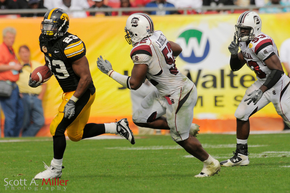 Jan 1, 2009; Tampa, FL, USA; Iowa Hawkeyes running back Shonn Greene (23) heads up field as he is chased by South Carolina Gamecocks linebacker Marvin Sapp (53) and linebacker Jasper Brinkley (52) during Iowa's 31-10 win in the Outback Bowl at the Raymond James Stadium. ©2009 Scott A. Miller
