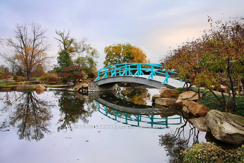 A Pastoral Scene Of A Japanese Foot Bridge Over A Quiet Little Pond On A Rainy Day In Autumn