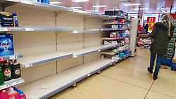 © Licensed to London News Pictures. 11/03/2020. London, UK. A shopper walks past empty shelves as Iceland store in London runs out of toilet rolls amid an increased number of cases of Coronavirus (COVID-19) in the UK. Major supermarkets have started to ration certain products after shoppers began to stockpile. Six coronavirus victims have died and 373 cases have tested positive of the virus. Photo credit: Dinendra Haria/LNP