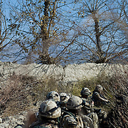 Dec 16, 2007 - Zhari District, Kandahar, Afghanistan -  Soldiers from the from the Royal Gurkha Rifles seen taking cover during Operation Terrah Toorah in the Siah Choy area in Zhari District located west of Kandahar City, Afghanistan. The operation was a Canadian lead effort in coordination with the Afghan National Army (ANA) and Royal Gurkha Rifles from the British Army. The Zhari district has become well known for insurgent activity and attacks on coalition forces..(Credit Image: © Louie Palu/ZUMA Press)