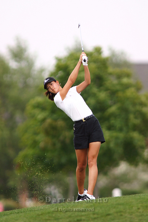 August 19, 2004; Dublin, OH, USA;  14 year old amateur Michelle Wie hits off the fairway during the 1st round of the Wendy's Championship for Children golf tournament held at Tartan Fields Golf Club.  <br />Mandatory Credit: Photo by Darrell Miho <br />&copy; Copyright Darrell Miho