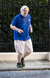© Licensed to London News Pictures. 04/07/2017. London, UK. Foreign Secretary Boris Johnson returns from a morning run before attending cabinet in Downing Street. Photo credit: Peter Macdiarmid/LNP