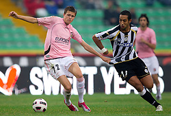 Josip Ilicic of Palermo vs Al Mouttaqui Medhi Benatia of Udinese during football match between Udinese Calcio and Palermo in 8th Round of Italian Seria A league, on October 24, 2010 at Stadium Friuli, Udine, Italy.  Udinese defeated Palermo 2 - 1. (Photo By Vid Ponikvar / Sportida.com)