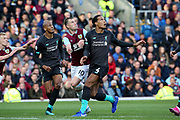 Liverpool defender Virgil van Dijk (4) Burnley forward Ashley Barnes (10) and Liverpool midfielder Fabinho (3) all watch the cross ball coming over during the Premier League match between Burnley and Liverpool at Turf Moor, Burnley, England on 31 August 2019.