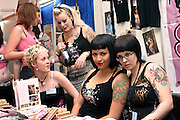 Groups of tatooed girls posing in front of their stall at the 2nd International Tattoo Convention in London on Saturday, Oct. 7, 2006, in London, UK. With over 15.000 visitors in three days during the 2005 edition, the event placed London in a central position in the tattoo world.  This year about 150 artists ,representing all the tattoo styles, are ticking away with their machines in a very exciting atmosphere. **ITALY OUT**....