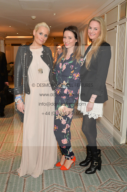Left to right, KALITA AL SWAIDI, KELLY EASTWOOD and EUGENIE WARRE at the launch of Mrs Alice in Her Palace - a fashion retail website, held at Fortnum & Mason, Piccadilly, London on 27th March 2014.