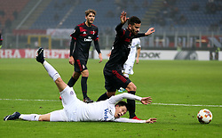 Austria Wien's Dominik Prokop and AC Milan's Mateo Musacchio battle for the ball