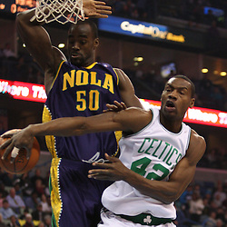 Feb 10, 2010; New Orleans, LA, USA; Boston Celtics guard Tony Allen (42) passes the ball behind his back as New Orleans Hornets center Emeka Okafor (50) defends during the first quarter at the New Orleans Arena. Mandatory Credit: Derick E. Hingle-US PRESSWIRE