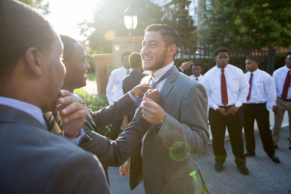 Johnathan Hill helps Matthew Mena with his bowtie prior to the Parents' Parting Ceremony at Morehouse College on Wednesday, Aug. 12, 2015 in Atlanta, Ga. Both men are juniors at Morehouse and helped with organizing the freshmen during the ceremony. Photo by Kevin D. Liles for The New York Times