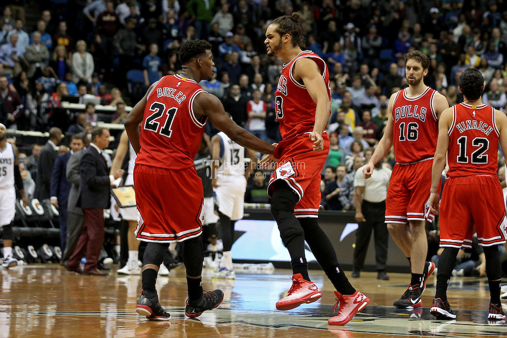 Nov 1, 2014; Minneapolis, MN, USA; Chicago Bulls guard Jimmy Butler (21) celebrates with forward Joakim Noah (13) during the fourth quarter at Target Center. The Bulls defeated the Timberwolves 106-105. Mandatory Credit: Brace Hemmelgarn-USA TODAY Sports