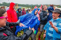 Wolf Alice play the Park Stage, fans dance in the rain. The 2015 Glastonbury Festival, Worthy Farm, Glastonbury.